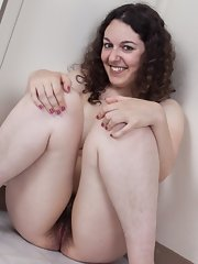 Girl hairy in nude chair sitting